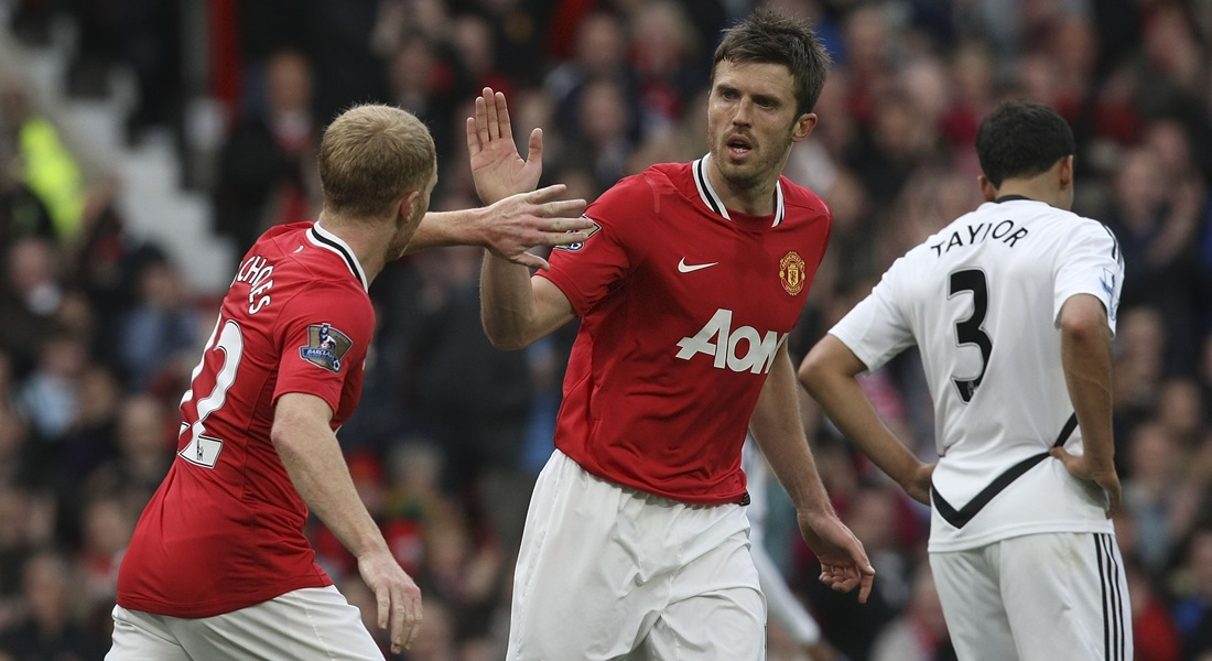 MANCHESTER, ENGLAND - MAY 06: Paul Scholes (L) of Manchester United celebrates scoring their first goal with Michael Carrick during the Barclays Premier League match between Manchester United and Swansea City at Old Trafford on May 6, 2012 in Manchester, England. (Photo by John Peters/Man Utd via Getty Images)